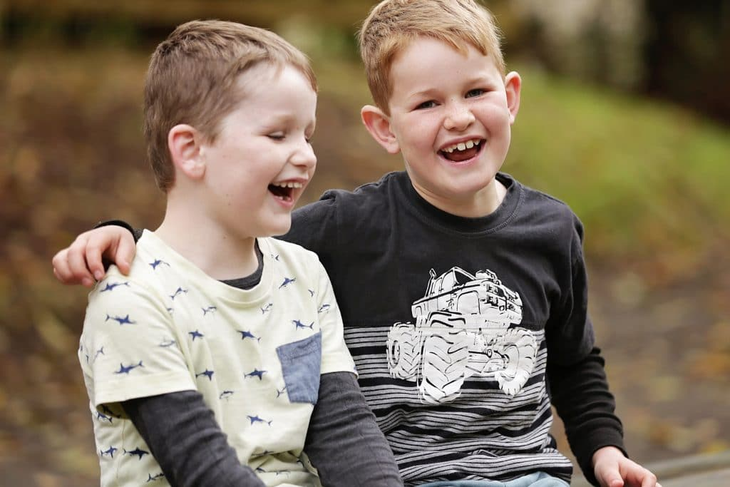 boys smiling at McLauren's Falls park captured by Tauranga children and family photographer Susanna
