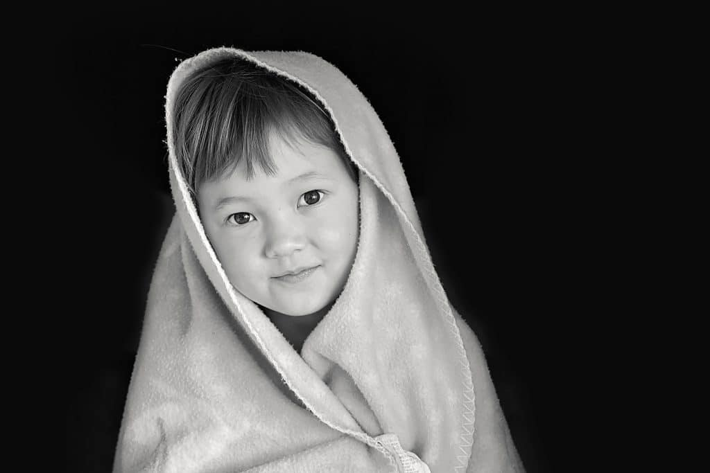 a formal black and white portrait of a little girl captured by Tauranga children and family photographer Susanna