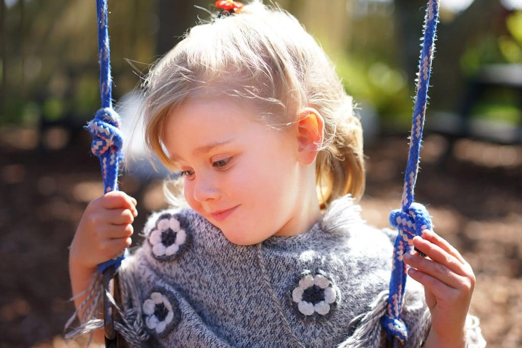 girl smiling on the swingcaptured by Tauranga children and family photographer Susanna