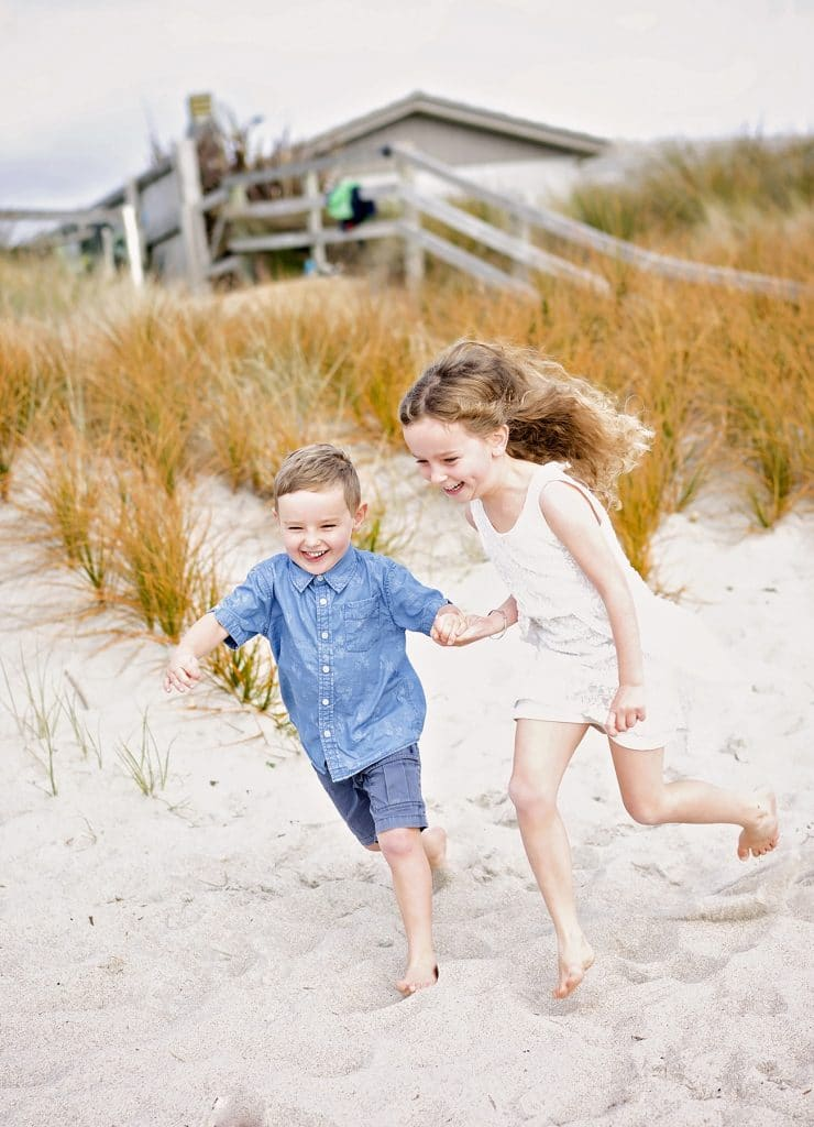 a photo of children running on the beach captured by Tauranga children and family photographer Susanna