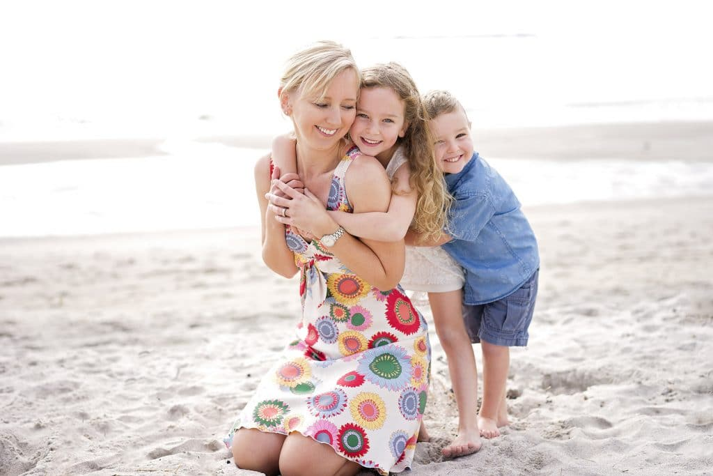 family portrait on Papamoa Beach captured by Tauranga children and family photographer Susanna