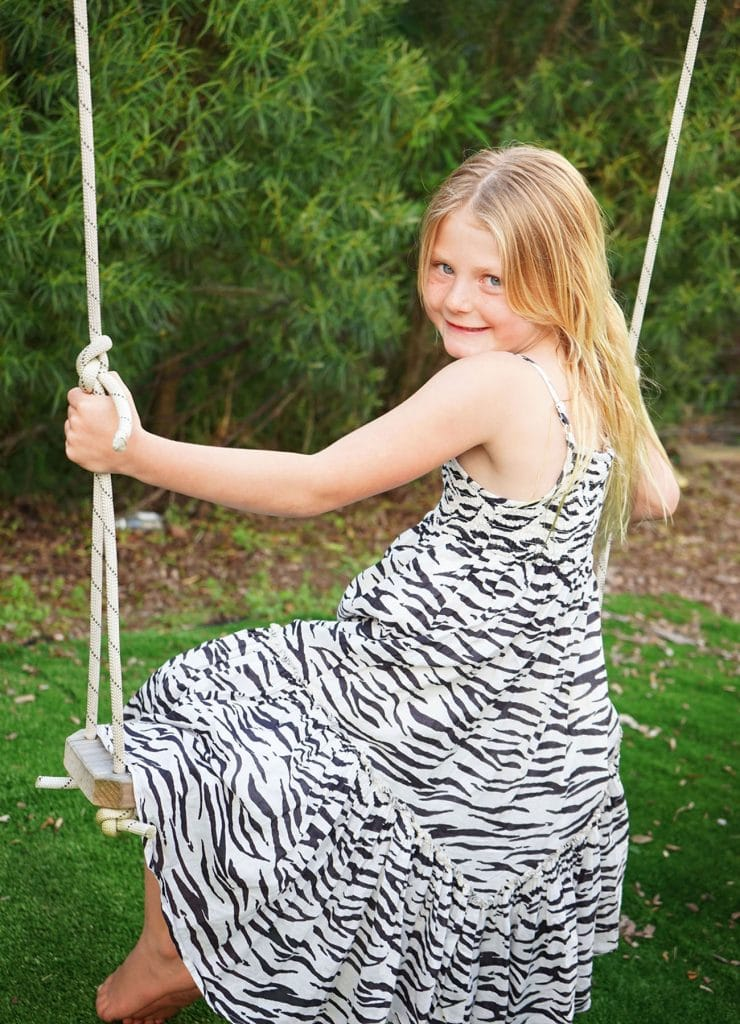 children portrait, a girl playing on the swingcaptured by Tauranga children and family photographer Susanna