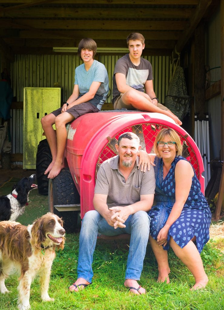 a portrait of the family outside their shed captured by Tauranga children and family photographer Susanna
